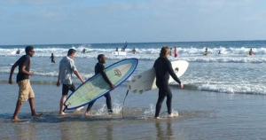surfers walking