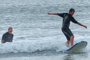 happy surfing african american boy